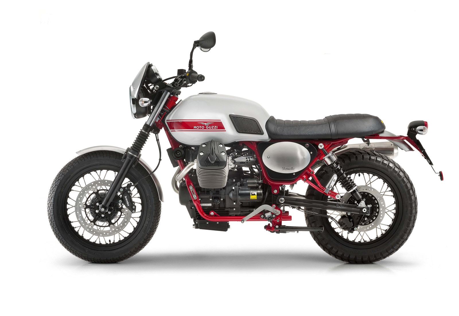 Moto de perfil, modelo Stornello, color gris con detalles en rojo. Marca Motoguzzi